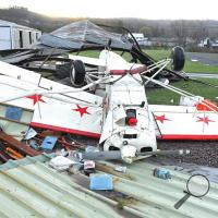 A high-wing airplane was tossed by the heavy winds that blew through the Benton area early Monday morning. The damaging winds tore apart the hangar for the plane, along with the Benton Borough maintenance shed at the airport.