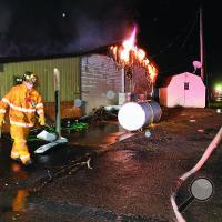 Fire crews battle a blaze at Mill Race Golf Course's clubhouse early Monday morning.