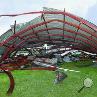 A hangar at the Benton Airport was torn from its supports early Monday morning.