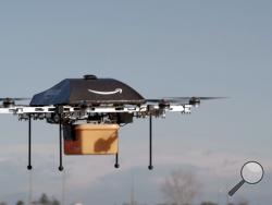 Amazon says it is testing these drones for delivery, and could have them in operation withing five years.