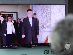 A woman watches a TV screen showing a file footage of North Korean leader Kim Jong Un, at Seoul Train Station in Seoul, South Korea, Monday, May 29, 2017. North Korea fired a short-range ballistic missile that landed in Japan's maritime economic zone Monday, officials said, the latest in a string of test launches as the North seeks to build nuclear-tipped ICBMs that can reach the U.S. mainland. (AP Photo/Lee Jin-man)