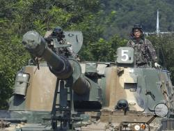 South Korean army soldiers drive a K-55 self-propelled howitzer during a military exercise in Paju, South Korea, near the border with North Korea, Monday, Sept. 4, 2017. North Korea said it set off a hydrogen bomb Sunday in its sixth nuclear test, which judging by the earthquake it set off appeared to be its most powerful explosion yet. (AP Photo/Ahn Young-joon)