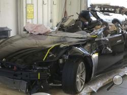 This image provided by the National Transportation Safety Board shows the damage to the left front of the Tesla involved in a May 7, 2016, crash in Williston, Fla. Investigators are meeting Sept. 12, 2017, to determine the likely cause of the crash that killed Joshua Brown, 40, of Canton, Ohio, who was using the semiautonomous driving systems of his Tesla Model S sedan. The sedan struck the underside of a semitrailer that was turning onto a divided highway in Williston. The sedan's roof was sheared off befo