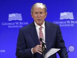FILE- In this Thursday, Oct. 19, 2017 file photo, former U.S. President George W. Bush speaks at a forum sponsored by the George W. Bush Institute in New York. Bush spoke Thursday at a summit in Abu Dhabi put on by the Milken Institute, an economic think tank based in Santa Monica, California. (AP Photo/Seth Wenig, File)
