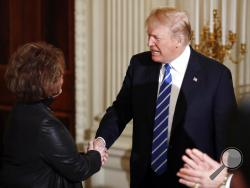 President Donald Trump shakes hands with Iowa House Speaker Linda Upmeyer, as he arrives in the State Dining Room of the White House in Washington, Monday, Feb. 12, 2018, during a meeting with state and local officials about infrastructure. (AP Photo/Carolyn Kaster)