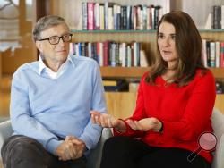 In this Feb. 1, 2018 photo, Microsoft co-founder Bill Gates and his wife Melinda take part in an interview with The Associated Press in Kirkland, Wash. The Gateses, as the world's top philanthropists, are rethinking their work in America as they confront what they consider their unsatisfactory track record on schools, the country's growing inequity and a president they disagree with more than any other. (AP Photo/Ted S. Warren)