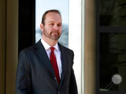 FILE - In this Dec. 11, 2017, file photo, Rick Gates, center, departs federal court in Washington. Robert Mueller's Russia investigation is illustrating an age-old truism: It pays to cooperate with the government. The few people who so have cooperated with the special counsel's office have enjoyed perks including the prospect of reduced prison sentences. Gates, for weeks on home confinement with electronic monitoring, gets rapid approval for a family vacation and shaves down his potential prison time. (AP P
