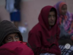 Central American migrants traveling with a caravan rest at the Salvation Army shelter for men upon arrival to Tijuana, Mexico, Thursday, April 26, 2018. Caravans have been a fairly common tactic for years among advocacy groups to bring attention to Central American citizens seeking asylum in the U.S. to escape political persecution or criminal threats from gangs. (AP Photo/Hans-Maximo Musielik)