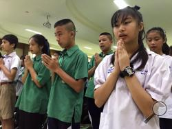 Students pray at Maesaiprasitsart school where six out of the rescued 12 boys study as they cheer the successful rescue in the Mae Sai district in Chiang Rai province, northern Thailand, Wednesday, July 11, 2018. A daring rescue mission in the treacherous confines of a flooded cave in northern Thailand has saved all 12 boys and their soccer coach who were trapped deep within the labyrinth, ending a grueling 18-day ordeal that claimed the life of an experienced volunteer diver and riveted people around the w