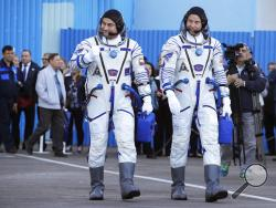 U.S. astronaut Nick Hague, right and Russian cosmonaut Alexey Ovchinin, member of the main crew of the expedition to the International Space Station (ISS), walk prior to the launch of Soyuz MS-10 space ship at the Russian leased Baikonur cosmodrome, Kazakhstan, Thursday, Oct. 11, 2018. (AP Photo/Dmitri Lovetsky, Pool)