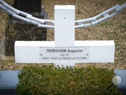 In this photo taken on Tuesday, Oct. 30, 2018, the grave marker of French WWI soldier Augustin Trebuchon in Vrigne-Meuse, France. His tiny plot is almost on the front line where the guns finally fell silent at 11 a.m. on the 11th day of the 11th month in 1918, after a four-year war that had already killed millions. Hundreds of troops died on the final morning of World War I _ even after an armistice was reached and before it came into force. Death at literally the 11th hour highlighted the futility of a con