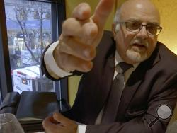FILE - In this image from video, a man who identified himself as Michel Lambert, a director at the Paris-based agricultural technology firm CPW-Consulting, reacts during an interview at a restaurant in New York on Thursday, Jan. 24, 2019. Days after this video was broadcast, the Israeli investigative television show Uvda and The New York Times reported that Lambert was Aharon Almog-Assouline, a former Israeli security official living in the tony Tel Aviv suburb of Ramat Hasharon. (AP Photo/Joseph Frederick)