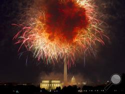 FILE - In this July 4, 2018, file photo, fireworks explode over Lincoln Memorial, Washington Monument and U.S. Capitol, along the National Mall in Washington, during the Fourth of July celebration. Independence Day is just over three weeks away, and nobody in Washington seems to know exactly what the July 4 celebrations in the nation s capital will look like. President Donald Trump has stated he wants to reshape the annual event into a Salute to America that would feature Trump himself speaking from the ste