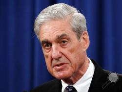 FILE - In this May 29, 2019, file photo, Special counsel Robert Mueller speaks at the Department of Justice in Washington, about the Russia investigation. House Democrats say preparations for next week's testimony by the special counsel in the Russia investigation include re-reading the report and watching old video of Mueller's testimony on other matters. (AP Photo/Carolyn Kaster, File)