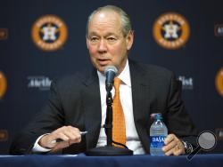 Houston Astros owner Jim Crane speaks at a news conference in Houston, Monday, Jan. 13, 2020. Crane opened the news conference by saying manager AJ Hinch and general manager Jeff Luhnow were fired for the team's sign-stealing during its run to the 2017 World Series title. (Yi-Chin Lee/Houston Chronicle via AP)