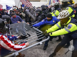 FILE - In this Jan. 6, 2021, file photo rioters try to break through a police barrier at the Capitol in Washington. Congress is set to hear from former security officials about what went wrong at the U.S. Capitol on Jan. 6. That's when when a violent mob laid siege to the Capitol and interrupted the counting of electoral votes. Three of the four testifying Tuesday resigned under pressure immediately after the attack, including the former head of the Capitol Police. Much is still unknown about the attack, an