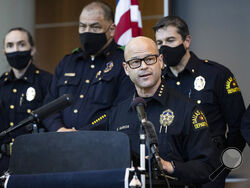 Chief Eddie García, center, speaks with media during a press conference regarding the arrest and capital murder charges against Officer Bryan Riser at the Dallas Police Department headquarters on Thursday, March 4, 2021, in Dallas. Riser was arrested Thursday on two counts of capital murder in two unconnected 2017 killings that weren't related to his police work, authorities said. Riser, a 13-year veteran of the force, was taken into custody Thursday morning and brought to the Dallas County Jail for process