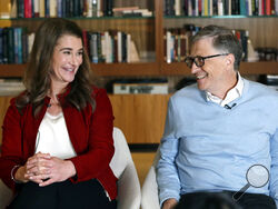 FILE - In this Feb. 1, 2019, file photo, Bill and Melinda Gates smile at each other during an interview in Kirkland, Wash. The couple announced Monday, May 3, 2021, that they are divorcing. The Microsoft co-founder and his wife, with whom he launched the world's largest charitable foundation, said they would continue to work together at The Bill & Melinda Gates Foundation. (AP Photo/Elaine Thompson, File)