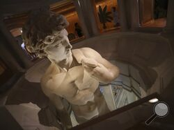 FILE - In this Friday, Oct. 1, 2021 file photo, a 3D re-production of Michelangelo's David is on display at the Italy's pavilion of the Dubai Expo 2020 in Dubai, United Arab Emirates. One of the most talked about attractions at the world's fair underway in Dubai is a towering statue made of marble dust that's raising eyebrows just as its original form did more than 500 years ago. (AP Photo/Kamran Jebreili, File)