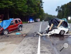 This Saturday, Aug. 31, 2013 photo shows the wreckage of two cars which collided on U.S. Route 219 in Hamlin Township, Pa. Police said the driver of the Jeep Liberty, left, crossed into oncoming traffic on a rural northwestern Pennsylvania highway and smashed head-on into the vehicle at right, killing six people, including two children. (AP Photo/The Bradford Era, Jay Bradish)