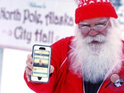 In this Wednesday, Dec. 28, 2016 photo, Santa Claus displays his now-functioning Facebook page outside North Pole City Hall in North Pole, Alaska. Santa Claus' Facebook account has been reinstated after the social media company suspended his access and demanded proof of identity on Christmas Day. Claus, a North Pole city councilman, said he was never given a reason why his page was blocked. A Facebook spokeswoman apologized in an email Tuesday, Dec. 27, for suspending Claus' account and said it was done by