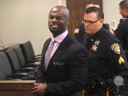 Arthur Morgan III winks at the cameras as he is lead off to jail after being found guilty of the murder of his daughter Tierra Morgan-Glover in Monmouth County Superior court in Freehold, N.J. on Thursday, April 3, 2014.