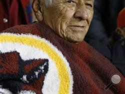 Roy Hawthorne, a member of the famed Navajo Nation Code Talkers, watches a football game between the Washington Redskins and San Francisco 49ers in Landover, Md. Four members of the famed Navajo Nation Code Talkers were honored at the Redskins game. The men's appearance at the game came during the Redskins' military appreciation night. But it's also fueling the debate over the team's mascot, which has been criticized as racist and offensive. (AP Photo/Evan Vucci)
