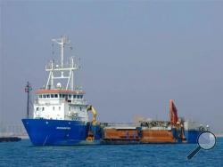 The Belgian ship Pompei, owned by De Nul, is shown in unidentified waters. One of Somalia's most notorious pirate leaders, Mohamed Abdi Hassan, was arrested in Brussels on Saturday, Oct. 12, 2013 and placed in custody pending charges, judicial sources said Monday. Hassan is suspected of the 2009 capture of the Belgian ship, the Pompei, which was held for over 70 days. (AP Photo/ Belgian Government)