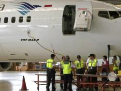 In this image from video taken on Tuesday, March 12, 2019, a Boeing 737 Max 8 aircraft is in hangar before the inspection at Garuda Maintenance Facility at Soekarno Hatta airport, Jakarta. The Indonesian Transport Ministry on Tuesday, March 13, conducted inspections of 737 Max 8 aircraft owned by Garuda Indonesia and Lion Air. (AP Photo)