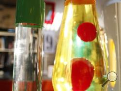 n this Monday, Aug. 19, 2013, lava lamps are photographed in a shop in London. The lava lamp, an iconic piece of British design and social trends, is celebrating its fiftieth birthday. Since its launch in 1963, Mathmos lava lamps have been in continuous production at their factory in Poole, Dorset. The company founder and eccentric inventor Edward Craven-Walker originally developed the lava lamp from an egg timer design he saw in a Dorset pub. (AP Photo/Lefteris Pitarakis)