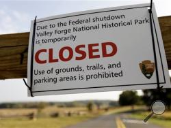 A sign is posted at an entrance to the closed Valley Forge National Historical Park Tuesday, Oct. 1, 2013, in Valley Forge, Pa. Congress plunged the nation into a partial government shutdown Tuesday as a long-running dispute over President Barack Obama's health care law stalled a temporary funding bill. (AP Photo/Matt Rourke)