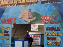 This undated photo shows the World's Smallest Woman exhibit at the Boulder County Fair in Longmont, Colo. The show featuring a 29-inch-tall woman from Haiti was closed Thursday, Aug. 7, 2014, after two parents complained, The (Longmont) Times-Call reported. (AP Photo/The Daily Times Call)