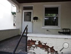 "This Saturday, Aug. 2, 2014 photo shows the home where an 8-year-old Pennsylvania boy whose decomposing body was found on the third floor in Harrisburg, Pa. Police charged Jarrod Tutko on Saturday with child endangerment, concealing the death of a child and abuse of a corpse. Harrisburg police said in a statement that Tutko informed his wife about the death of their son, Jarrod Tutko Jr., ""when the odor of decomposition became too strong."" (AP Photo/PennLive.com, Sean Simmers)"