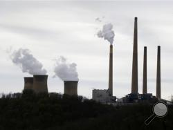 "This photo taken May 5, 2014 shows the stacks of the Homer City Generating Station in Homer City, Pa. Three years ago, the operators of one of the nation's dirtiest coal-fired power plants warned of ""immediate and devastating"" consequences from the Obama administration's push to clean up pollution from coal. (AP photo)"