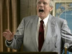 Rev. Fred Phelps Sr. preaches at his Westboro Baptist Church in Topeka, Kan. Phelps, the founder of the Kansas church known for anti-gay protests and pickets at military funerals, died Thursday, March 20, 2014. He was 84. (AP Photo/Charlie Riedel, File)