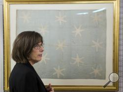 In this Thursday, June 5, 2014 photo textile conservator Virginia Whelan who recently preserved George Washington's flag, which flew to denote his presence at various battles during the war against Britain, speaks during an interview with the Associated Press at the Museum of the American Revolution's facility near Philadelphia. (AP Photo/Matt Rourke)