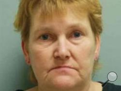 Sherry Kay Gillock of Monessen, whom police say locked her 75-year-old mother and 15-year-old son in the basement after returning home drunk from a bar.