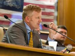 Republican state Sen. Stacey Campfield of Knoxville speaks at a Senate subcommittee hearing in Nashville, Tenn. Campfield was criticized by leaders of both the Republican and Democratic parties in Tennessee on Monday, May 5, 2014, for writing a blog post likening the insurance requirement under President Barack Obama's health care law to the forced deportation of Jews during the Holocaust. (AP Photo/Erik Schelzig, File)