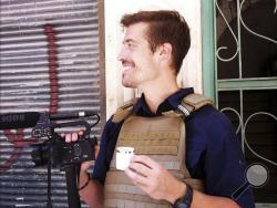 This file photo posted on the website freejamesfoley.org shows journalist James Foley in Aleppo, Syria, in July, 2012. (AP Photo/freejamesfoley.org, Nicole Tung, File)