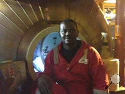 In this image made available Tuesday Dec. 3, 2013, Harrison Odjegba Okene poses for a portrait inside a decompression chamber after being rescued from three days underwater. (AP Photo)
