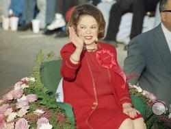 FILE - In this Jan. 1, 1999 file photo, Grand Marshall Shirley Temple Black waves to the crowd as she rides along the 110th Tournament of Roses Parade route in Pasadena, California.(Associated Press)