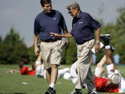 "Penn State football coach Joe Paterno, right, walking with his son and quarterback coach Jay Paterno as players stretch out during practice in State College, Pa. Jay Paterno is the author of the book, ""Paterno Legacy: Enduring Lessons from the Life and Death of My Father."" Joe Paterno told his son the day after his firing that he hadn't informed the coaching staff about allegations Jerry Sandusky may be a child molester because he was unsure whether they were true, Jay Paterno writes. (AP)"