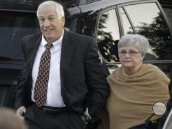 "Jerry Sandusky arrives with his wife, Dottie Sandusky, for a preliminary hearing at the Centre County Courthouse in Bellefonte, Pa. Dottie Sandusky has been granting interviews in recent weeks, arguing her husband's conviction was unjust and claiming the victims who testified against him told inaccurate stories to cash in. An attorney involved in negotiating with Penn State on behalf of his victims calls her denials ""obscene."" (AP Photo/Gene J. Puskar, File)"