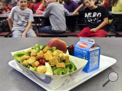 In this Tuesday, Sept. 11, 2012 file photo, a select healthy chicken salad school lunch, prepared under federal guidelines, sits on display at the cafeteria at Draper Middle School in Rotterdam, N.Y. After just one year, some schools across the nation are dropping out of what was touted as a healthier federal lunch program, complaining that so many students refused the meals packed with whole grains, fruits and vegetables that their cafeterias were losing money. (AP Photo/Hans Pennink, File)