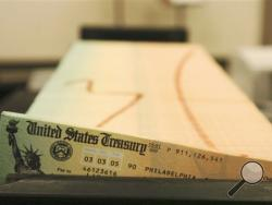 For the second straight year, millions of Social Security recipients can expect an historically small increase in benefits come January 2014. (AP Photo/Bradley C. Bower, File)