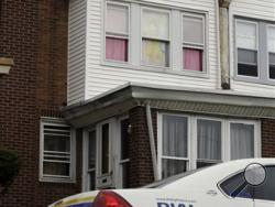 A police car sits in view of a decorated window in the home of a severely disabled 3-year-old girl who was pronounced dead at a nearby hospital, Monday, Sept. 9, 2013, in Philadelphia. Nathalyz Rivera, a twin, weighed just 11 pounds when she died and police in Philadelphia called her death a homicide. (AP Photo/Matt Rourke)