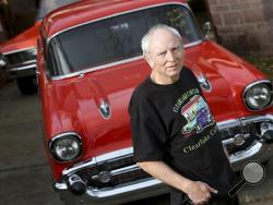 kip Wilson poses in front of his 1957 Chevrolet Bel Air that was stolen in 1984 and returned to him by the California Highway Patrol on Monday, February 17, in Clearlake Oaks, Calif. Three decades after it was stolen, a 1957 Chevrolet Bel Air has been returned to a Northern California man, in better shape than when he originally owned it. (AP photo)