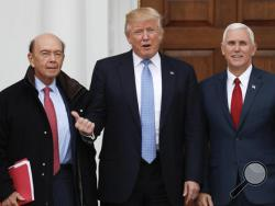 President-elect Donald Trump, center, and Vice President-elect Mike Pence, right, pose with investor Wilbur Ross at the Trump National Golf Club Bedminster clubhouse, Sunday, Nov. 20, 2016, in Bedminster, N.J.. (AP Photo/Carolyn Kaster)