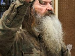 File-This Nov. 7, 2013 file photo shows Phil Robertson, the Duck Commander, holding the 1 millionth duck call assembled for 2013 at company's warehouse in West Monroe, La. (AP Photo, The News-Star/Margaret Croft)