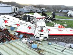 A high-wing airplane was tossed by the heavy winds that blew through the Benton area early Monday morning. The damaging winds tore apart the hanger for the plane, along with the Benton Borough maintenance shed at the airport. (Press Enterprise/Keith Haupt)